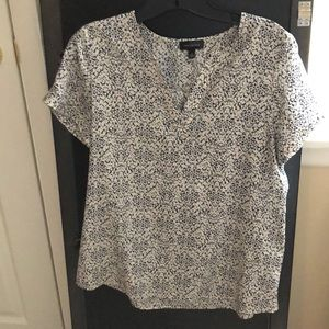 The limited short sleeve v neck blouse